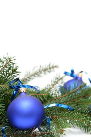 Blue christmas bulbs on a white background photo