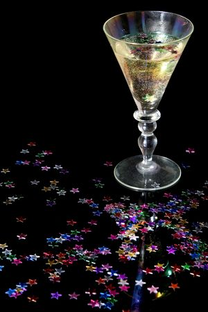 Glass of champagne on a black background photo