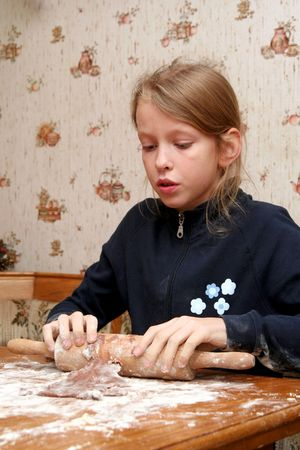 Children making christmas cookies in the kitchen photo