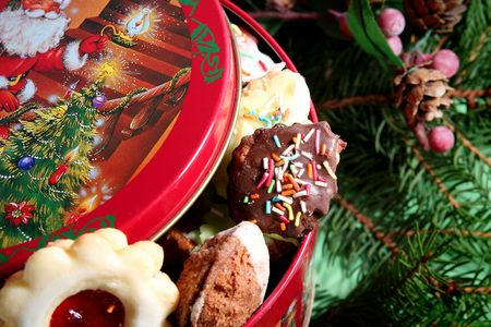 Children made christmas cookies in the christmas tin photo