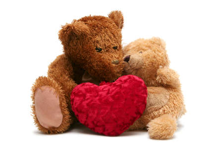 Teddy bear with soft heart on a white background Stock Photo