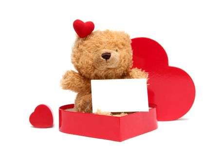 Teddy bear with heart shaped box on a white background photo