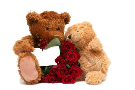 Teddy bear with red roses on a white background Stock Photo