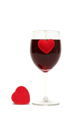 Red heart and glass of wine on a white background photo