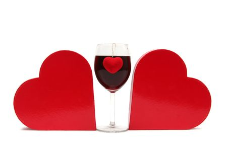 amore: Red heart and glass of wine on a white background Stock Photo