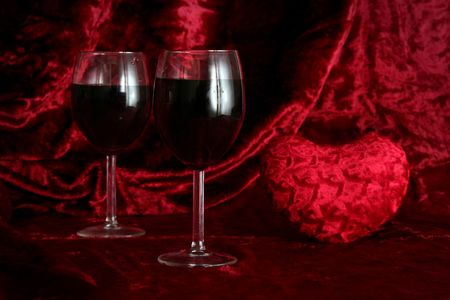 Glass of wine on a dark red background photo