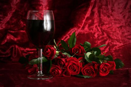 Glass of wine on a dark red background Stock Photo - 703459
