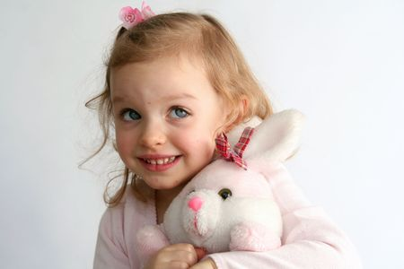 Little  girl and pink bunny toy photo