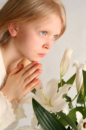 Little girl praying on the easter lilies background Stock Photo - 847004