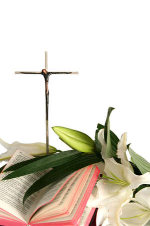 Cross and white easter lilies on a white background photo