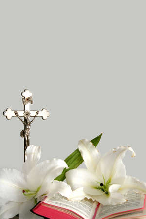 crucify: Opened prayerbook and old cross  on a white background