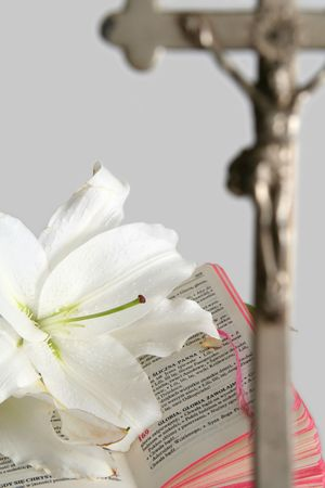 Opened prayerbook and old cross  on a white background photo