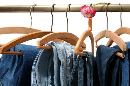 garb: Blue jeans trousers and big pink daisy Stock Photo