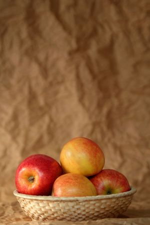 pome: Yellow and red apples on a beige background Stock Photo