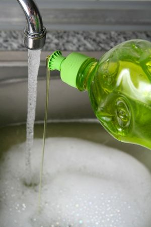 Filling the metallic kitchen sink with water Stock Photo - 946836