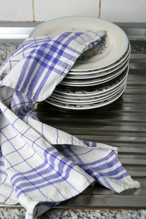 Dishes wiped with white blue checked dishtowel photo