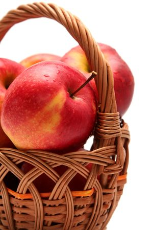 Red fresh apples in basket on a white background Stock Photo
