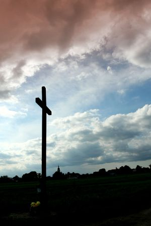 Wooden  catholic cross   on a sky background