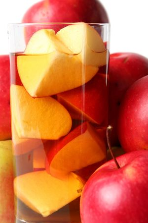 pome: Red apples and apple juice on a white background