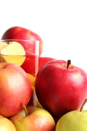 Red apples and apple juice on a white background   photo