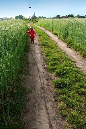 rood: Little girl going towards the field cross