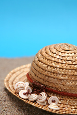 Summer straw hat brimmed  with little shells photo