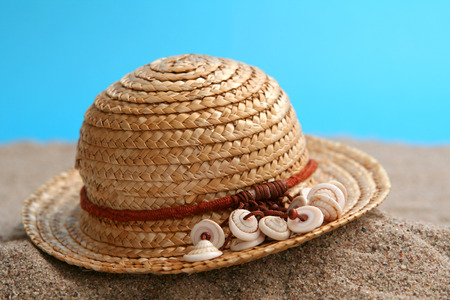 Summer straw hat brimmed  with little shells