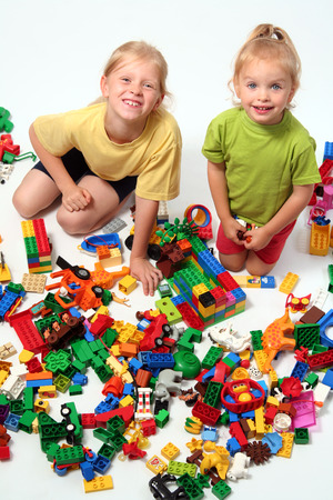 Little children playing with colorful cube blocks