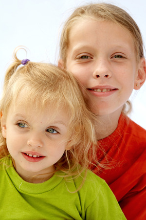 Portrait of young girls wearing red t-shirts photo