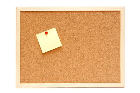 Colorful paper stickers on a corkboard photo