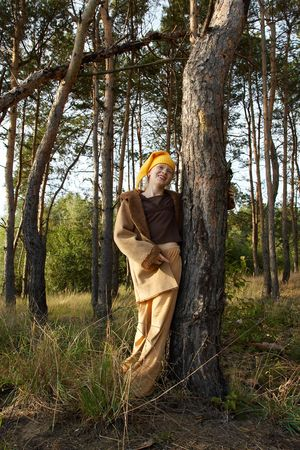 Children wearing yellow caps in autumnal forest photo
