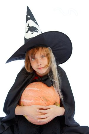 Young blond girl dresses in hallowwen witch costume. Stock Photo - 1861938