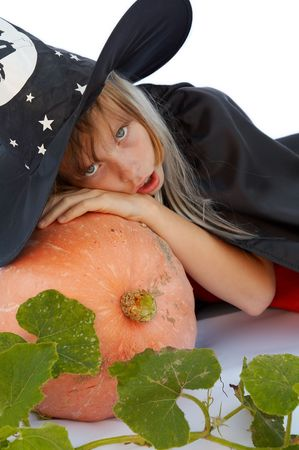 Young blond girl dresses in hallowwen witch costume. Stock Photo - 1861948