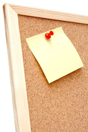 corkwood: Pegatinas de colores de papel en un corkboard Foto de archivo