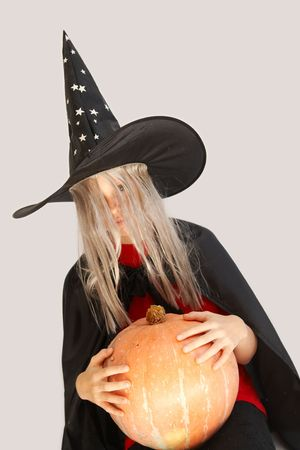 Young blond girl dresses in hallowwen witch costume. Stock Photo - 1908575