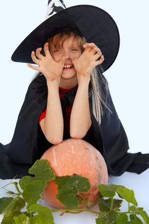 Young blond girl dresses in hallowwen witch costume. Stock Photo - 1976622