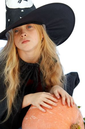 Young blond girl dresses in hallowwen witch costume. Stock Photo - 1976631