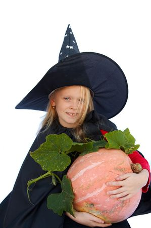 Young blond girl dresses in hallowwen witch costume. Stock Photo - 1976621