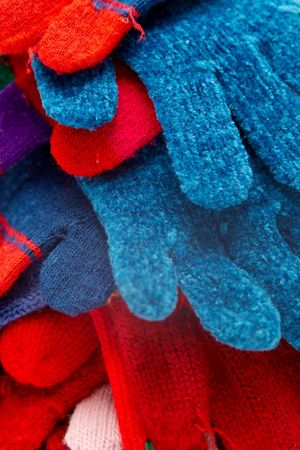 Colorful woolen gloves on a white background Stock Photo - 2046128