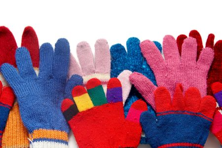 Colorful woolen gloves on a white background Stock Photo - 2074120