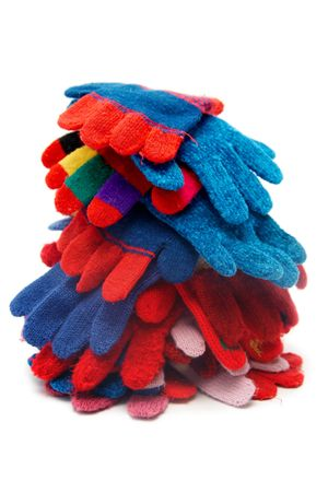 Colorful woolen gloves on a white background Stock Photo - 2112069