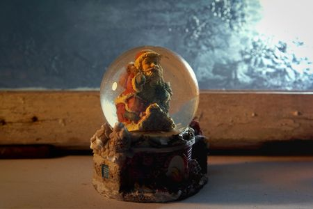 Crystal ball on a frozen glass background photo