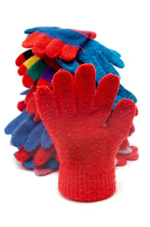 woolen cloth: Colorful woolen gloves on a white background