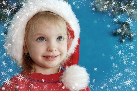 Children wearing Santa Claus hats and snowflake frame