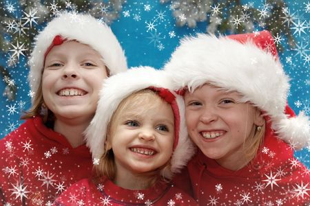 redness: Children wearing Santa Claus hats and snowflake frame
