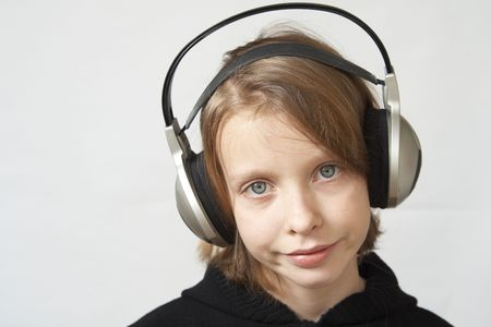 Young girl listening to the music with headphones Stock Photo - 2427715