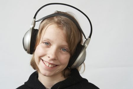 Young girl listening to the music wth headphones Stock Photo - 2460661