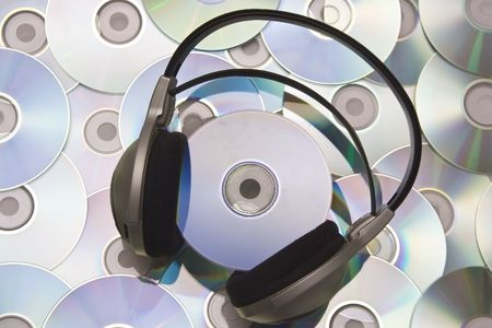 writable: Grey and black earphones and compact disc Stock Photo