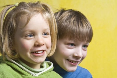 Portrait of happy children on a yellow background Stock Photo - 2705313