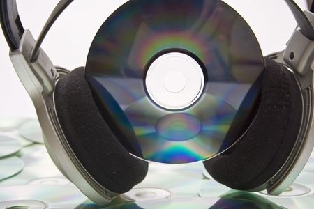 Grey and black earphones and compact disc photo
